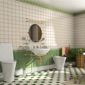 salle de bain avec évier, toilette et bidet